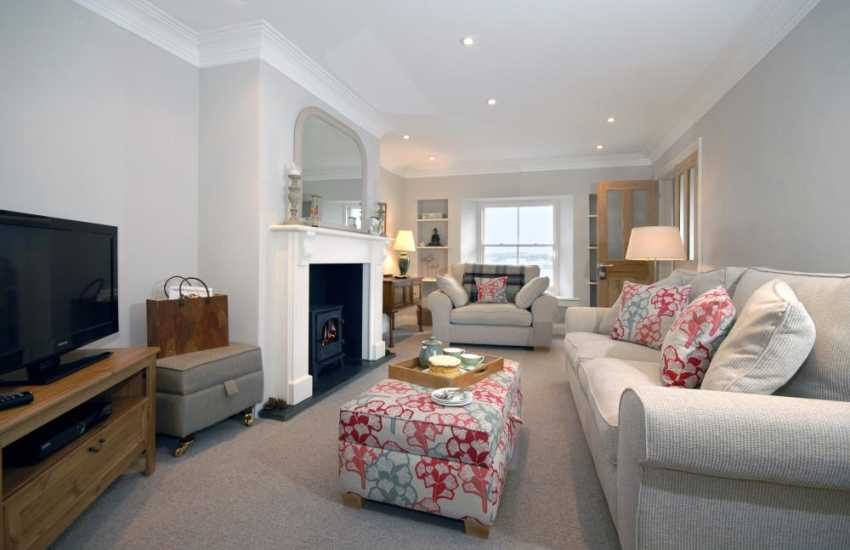Pembrokeshire holiday house with fabulous river views - lounge with oil burning stove