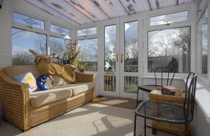 Pembrokeshire self catering accommodation - sun room with garden views