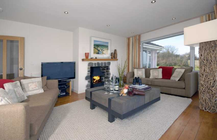 North Pembrokeshire holiday bungalow - lounge with open fire, Freeview t.v. WIFI/Internet