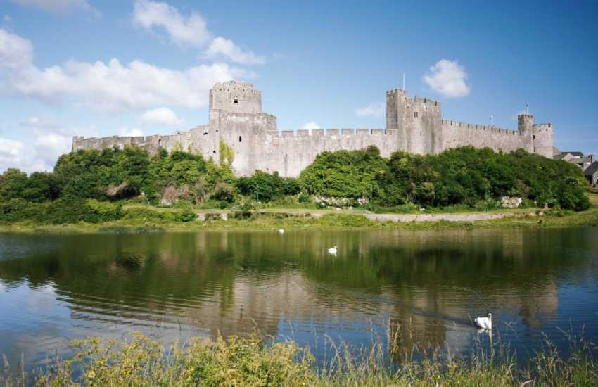 Medieval Pembroke Castle and birthplace of Henry VII. Falconry displays, music festivals and historical events take  place throughout the year