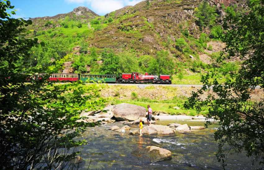 The Welsh Highland railway running alongside the river at the Aberglasllyn gorge