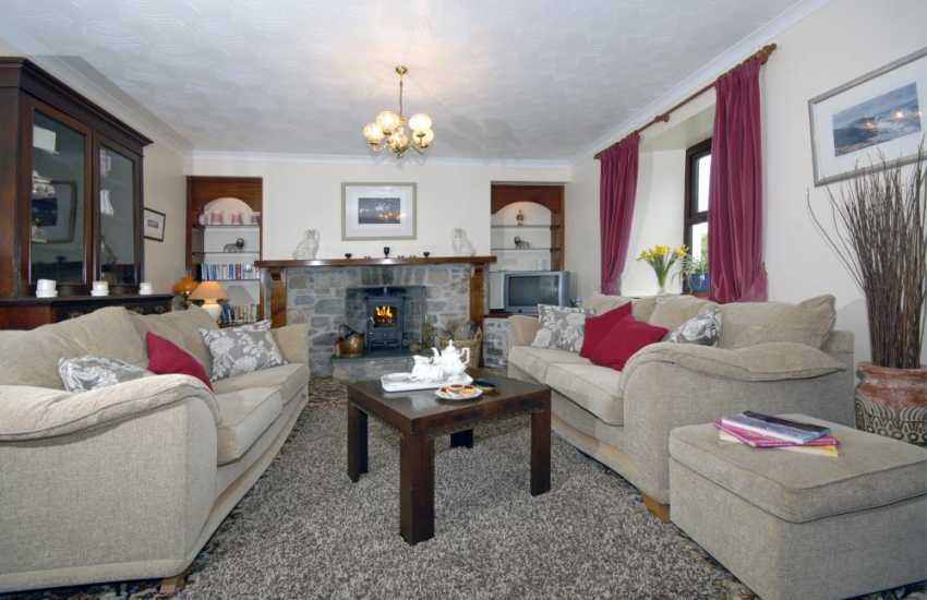 North Pembrokeshire holiday farmhouse - sitting room with log burning stove
