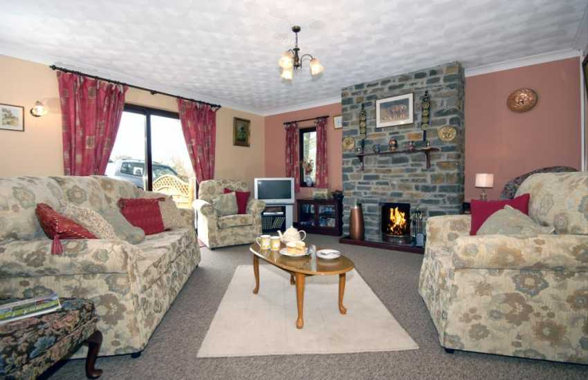 Pembrokeshire holiday cottage near the coast pets welcome - sitting room with open fire