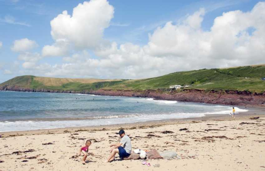 Manorbier Beach is a great favourite with rock pools to fish in and wonderful waves for swimmers and surfers alike
