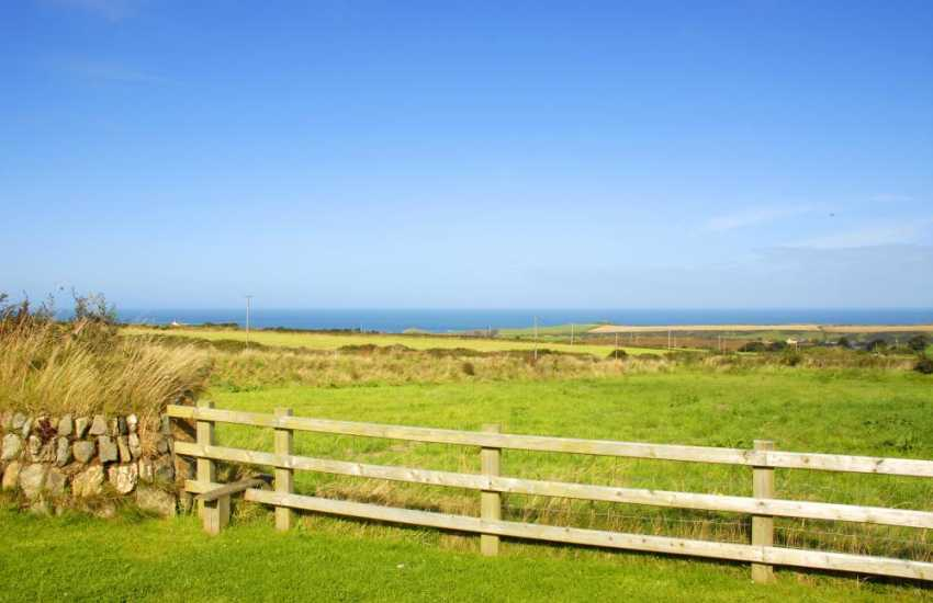 Fabulous coastal views with a style from the garden leading into a large field - great for all sorts of ball games