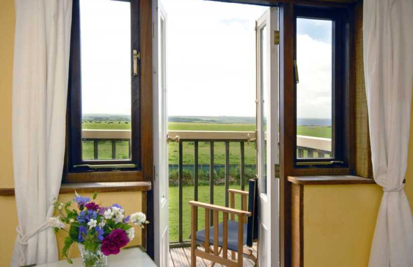 Fabulous views to the surrounding coastline from the little balcony off the double bedroom