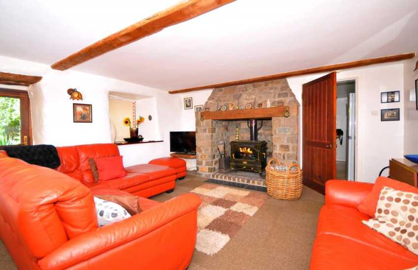 Welsh coastal cottage - sitting room with log burner