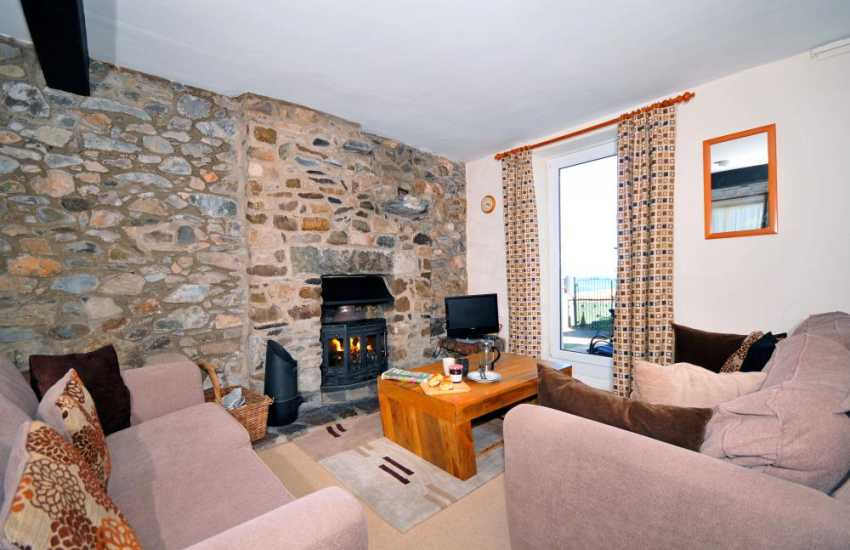 Inglenook fireplace with log burner in Beautiful holiday home close to Criccieth beach