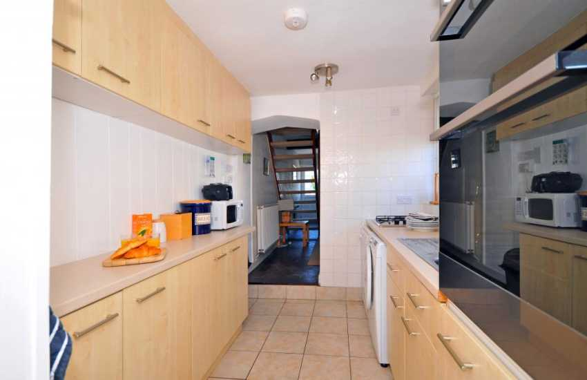 Galley kitchen in Criccieth cottage sleeps 6 close to beach
