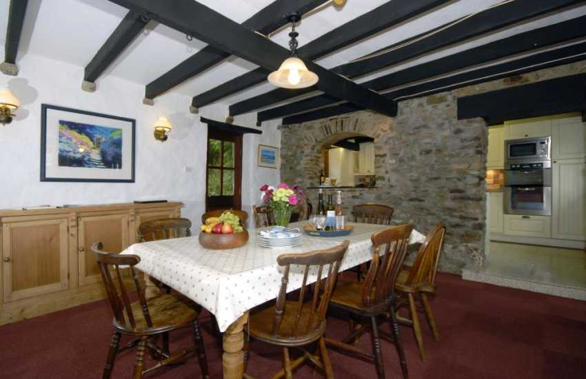 Rural farmhouse near Newgale - dining room with feature stone arch