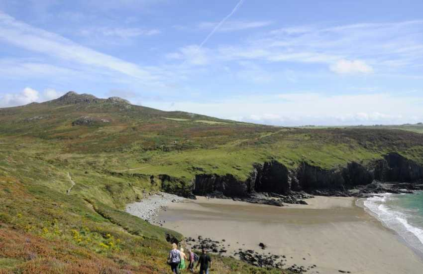 Past Whitesands the path dips down to the tiny beach at Porthmelgan and Carn Llidi 'mountain' rises up behind