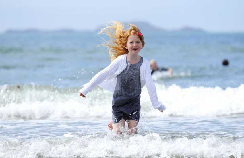 Having fun on the beach at Whitesands Bay