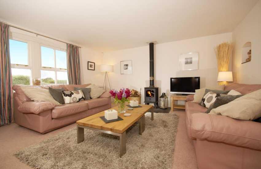 Bosherston village holiday cottage - sitting room with wood-burning stove