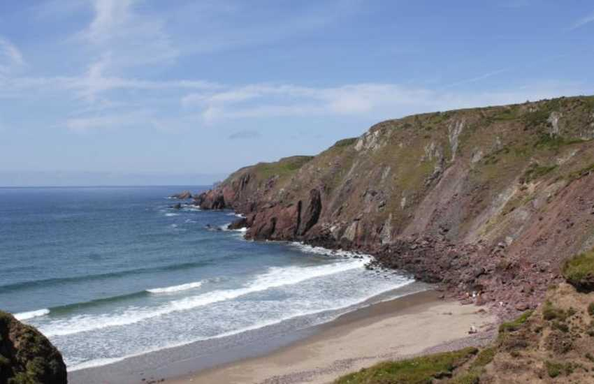 West Dale is a sandy beach enclosed by towering cliffs and popular for surfing
