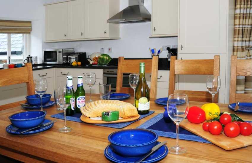 Open plan kitchen/diner on ground floor in cottage near newborough Sands