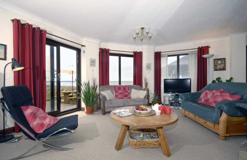 Newgale holiday cottage by the beach - sitting room with patio doors to the terrace
