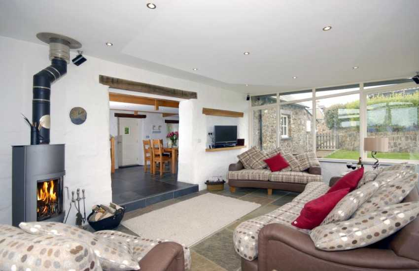 St Davids luxury holiday home - open plan living area with wood burning stove