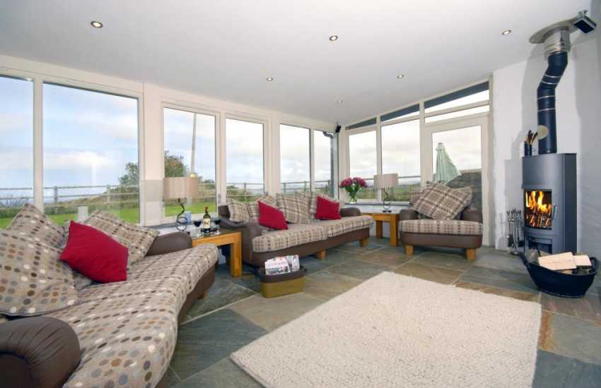 North Pembrokeshire holiday cottage - sitting room with log burning stove and sea views