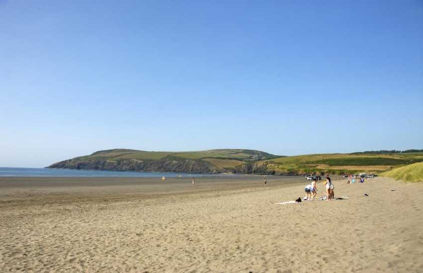 Newport Sands. A long sandy beach, popular with water sport enthusiasts, and dog friendly all year round