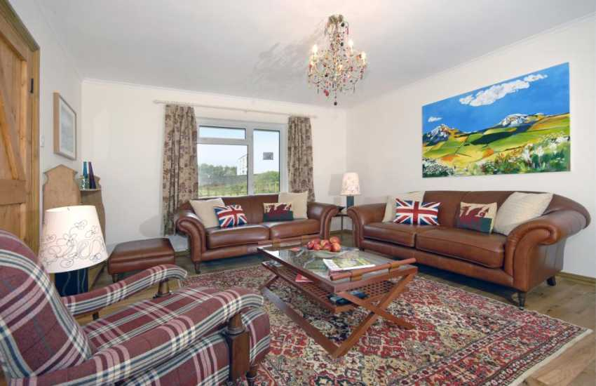 North Pembrokeshire holiday home - lounge with leather furniture and open fire