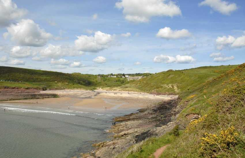 Medieval Manorbier Castle overlooks the sandy beach - very popular with families, surfers and great for rock pooling