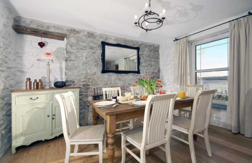 Welsh stone holiday cottage - dining area with river views