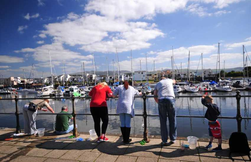 Crabbing on the harbour in Porthmadog