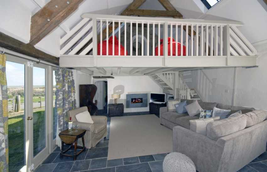 Pembrokeshire Coast holiday home - comfortable open plan lounge with feature gas fire place