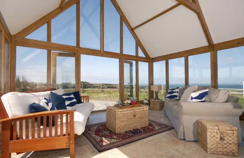 Martins Haven converted barn - conservatory with sea views