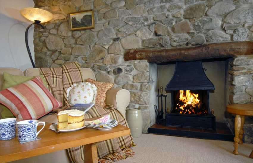 Curl up with tea and cake by the open fire at this cosy Pembrokeshire cottage