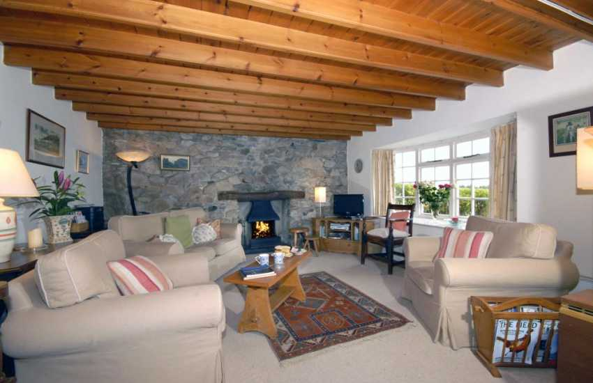 North Pembrokeshire cosy holiday cottage - lounge with open fire and sea views