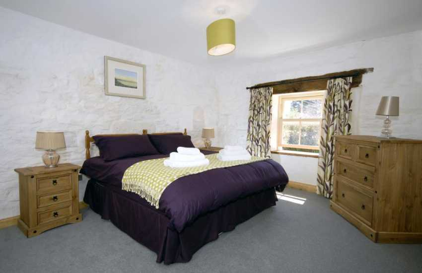 North Pembrokeshire cottage master bedroom with en-suite bathroom