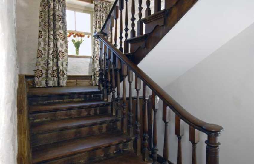 St Brides Bay holiday home - turning staircase & quarry tiled floors