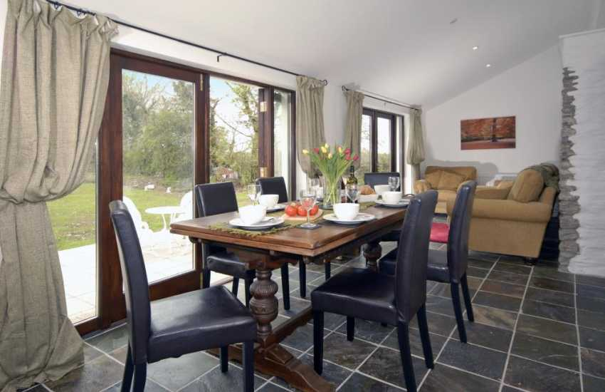 Restored Welsh barn - dining/sitting room with garden views