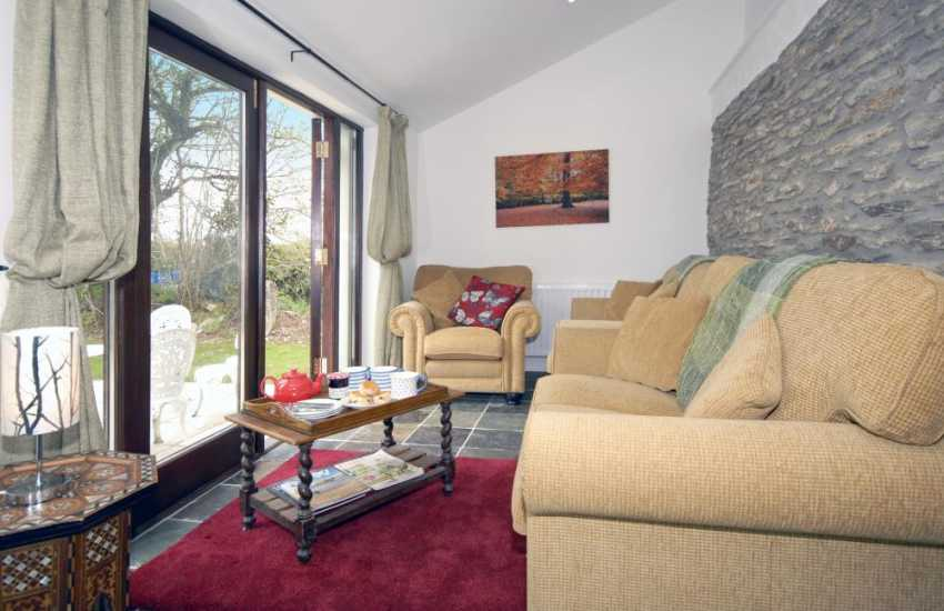 Aberporth holiday accommodation - cosy sitting area with patio doors to gardens