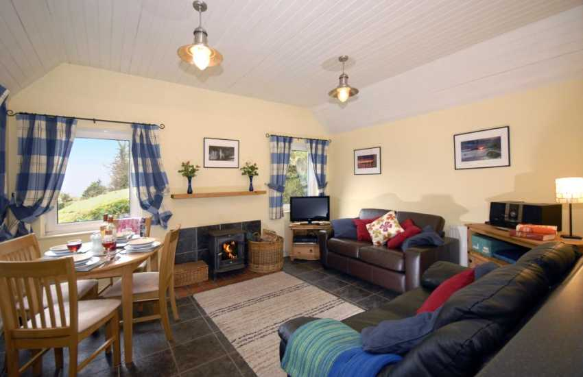 Cottage near Laugharne and Pendine - cosy open plan lounge/diner with wood burning stove