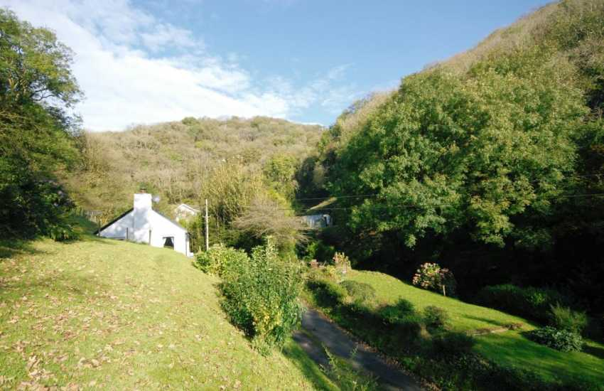Cottage in tranquil valley near the sea