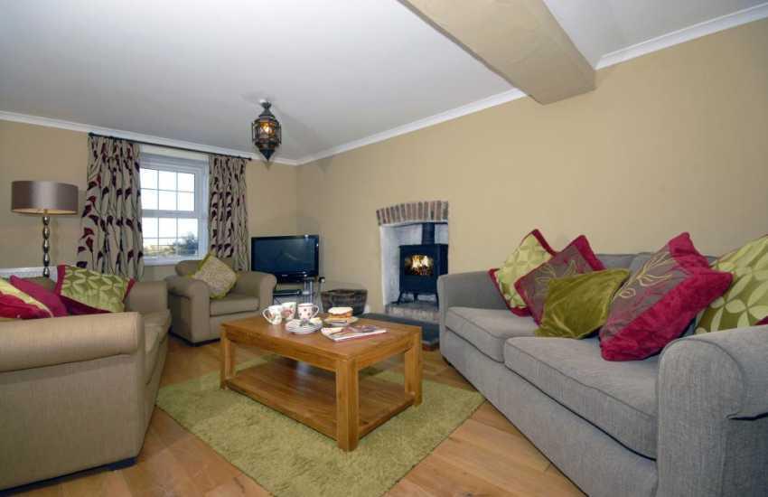 Pembrokeshire coast holiday farmhouse - comfy lounge with wood burning stove