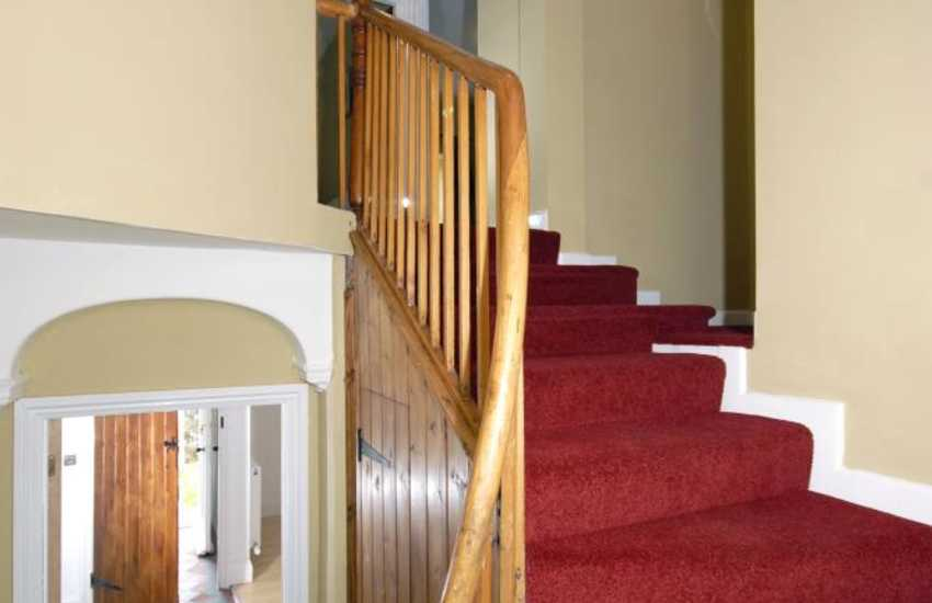 St Brides Bay holiday home - quarry tiled entrance hall and turning staircase