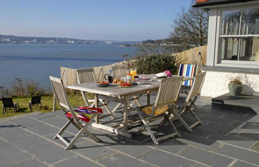 Breathtaking views across the shimmering broad expanse of Pembrokeshire's Haven Waterway from the patio of this fabulous holiday home