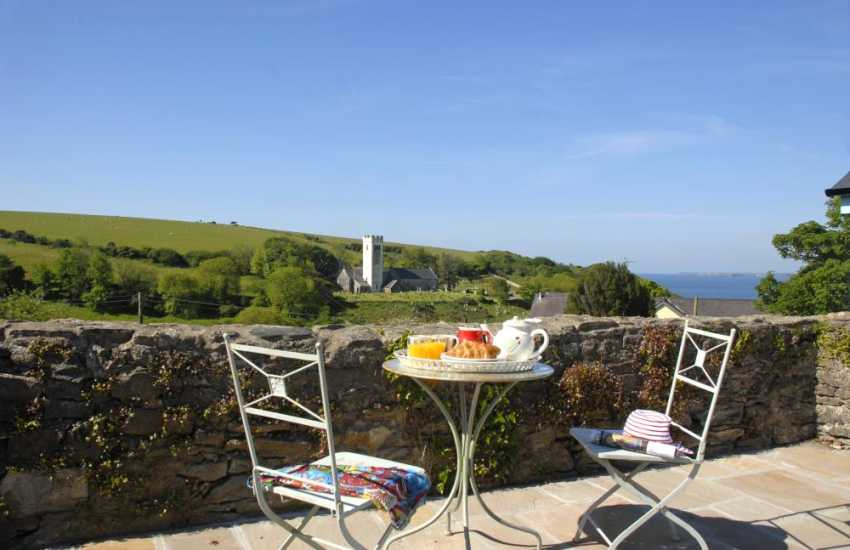 Enjoy fabulous coastal views from the private patio