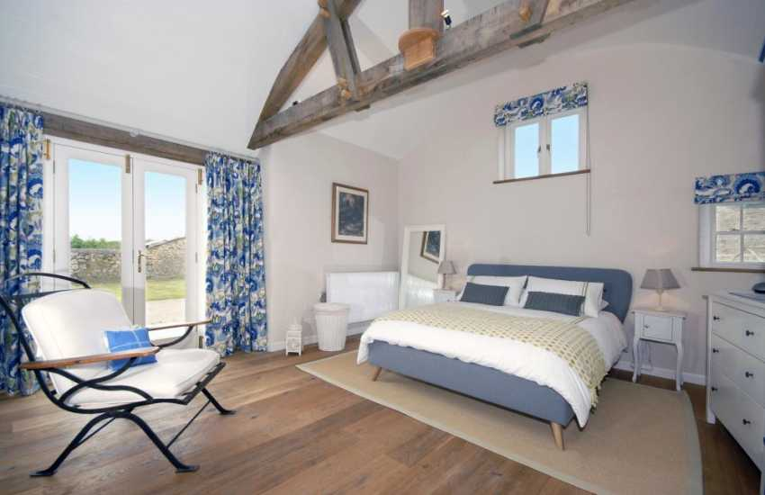 Marloes Sands holiday house - master king size bedroom with en-suite shower