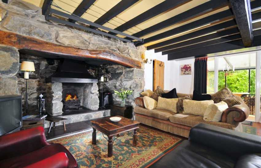 Farmhouse cottage - lounge with inglenook fire place near Caernarfon