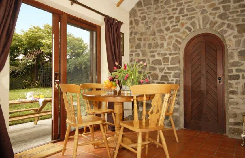 Cottage near Fishguard - dining area with doors to garden