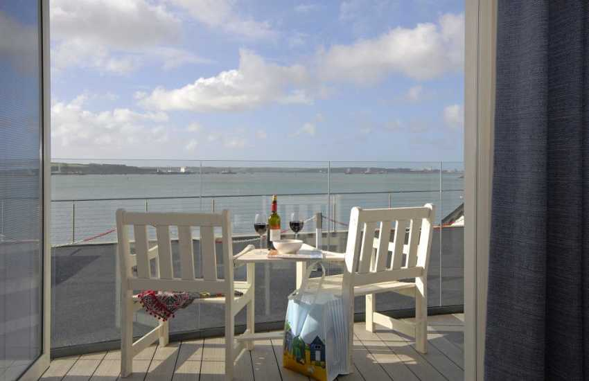 Enjoy fabulous panoramic views over the Haven Waterway from this luxury ground floor apartment