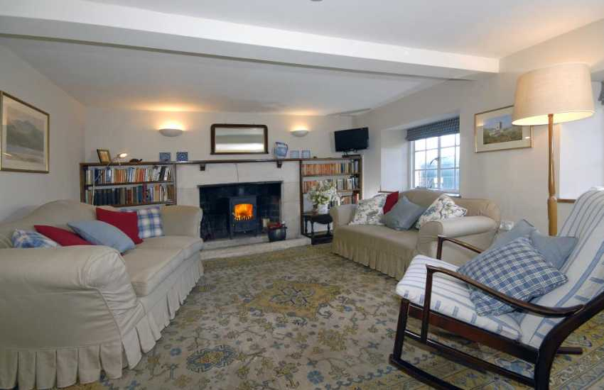 Pembrokeshire Coast National Park restored holiday house - parlour with wood burning stove