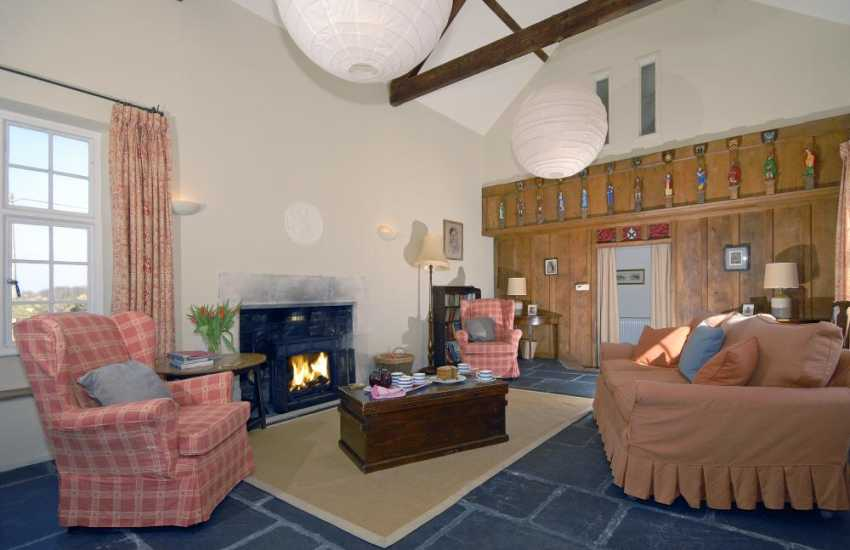 St Davids holiday house - sitting room with medieval style Elm carved wall