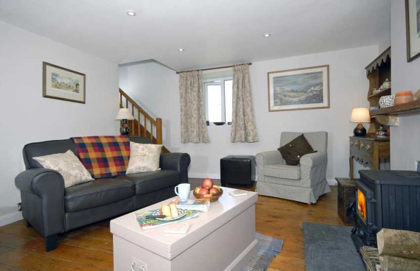 Porthgain self catering cottage - sitting room with log burning stove
