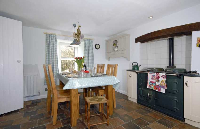 St Davids self catering cottage - kitchen/diner with feature Aga