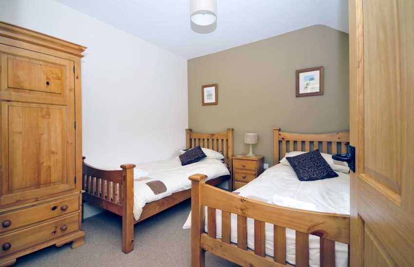 Twin bedroom at this Aberdaron family holiday cottage